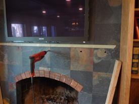 Photo of Holes being Drilled Into Mantel Wall