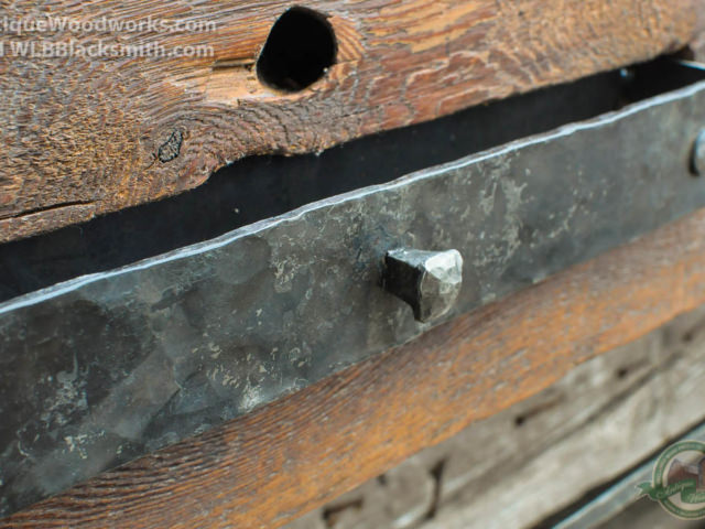 Close-up of unique hidden metal drawer filling a mortise pocket in mantel.