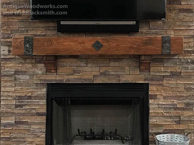 Hand hewn mantel with corbels, metal straps, and metal accents.